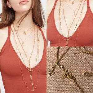 NWOT free people golden charms necklace layered